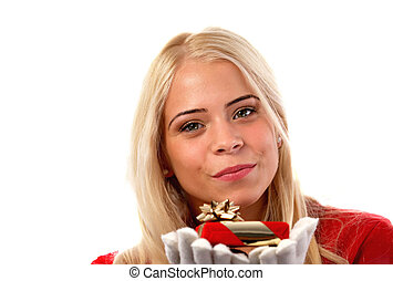 Young woman holding a gift