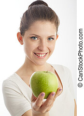 young woman holding a green apple
