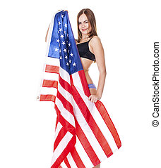 Young woman holding a large American flag