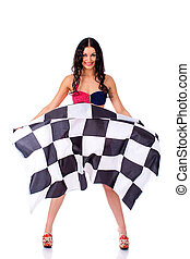 Young woman holding a large checkered flag