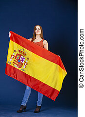 Young woman holding a large Spanish flag