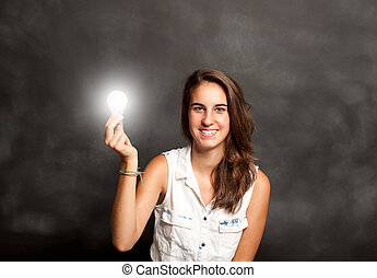 young woman holding a lightbulb