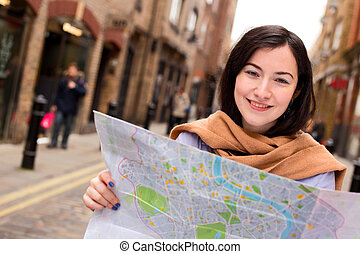 young woman holding a map.