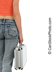 Young woman holding a metal case