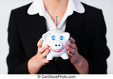 Woman Holding a piggy bank with dollars in it