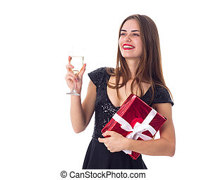 Young woman holding a present and a glass of champagne