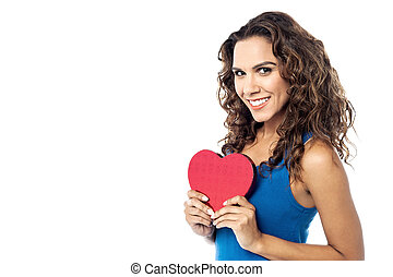 Young woman holding a red paper heart