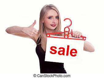 Young woman holding a sale sign, isolated on white