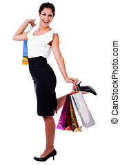 young woman holding a shopping bag with