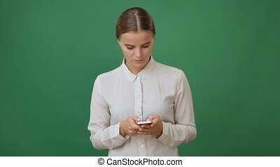 Young woman holding a smartphone