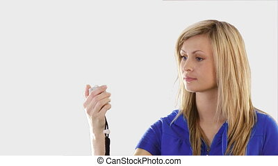 Woman holding a stop watch - Young Woman holding a stop...