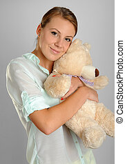 Young woman holding a teddy bear