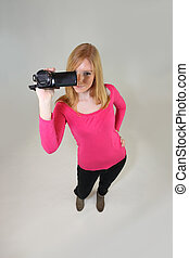 Young woman holding a video camera