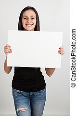 Young woman holding a white board