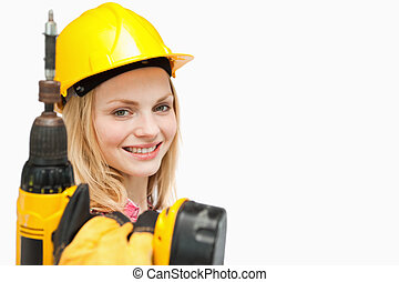 Young woman holding an electric screwdriver