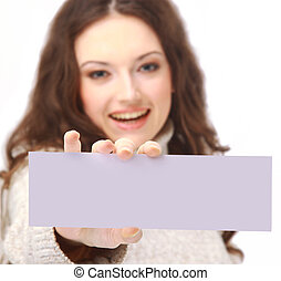 Young woman holding an empty billboard