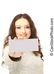 Young woman holding an empty billboard over white background
