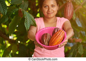 Young woman holding cacao rip