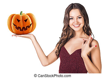 Young woman holding carved pumpkin.