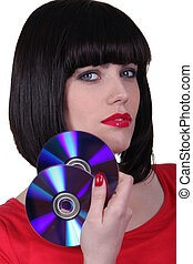 Young woman holding cds