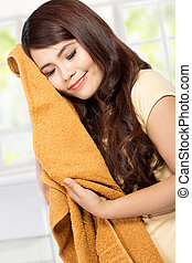 young woman holding clean clothes