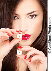 young woman holding dices