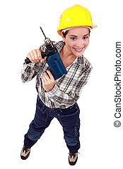 Young woman holding drill