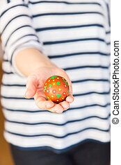 Young woman holding easter egg