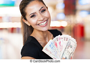 young woman holding fan of cash in casino - happy young ...