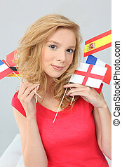Young woman holding flags