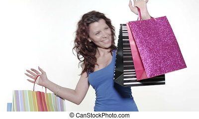 Young woman holding gift bags