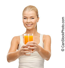 woman holding glass of orange juice