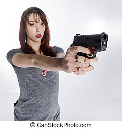 Young Woman Holding Hand Gun with Both Hands