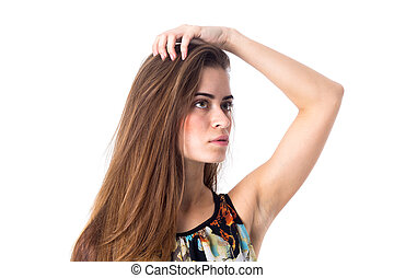 Young woman holding hand on her head