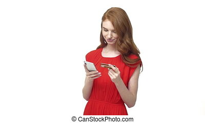 Young Woman Holding Her Credit Card About To Make An Online Shopping Purchase on Mobile Phone Digital Ecommerce Making A Decision For Online Payment Concept Slow Motion.