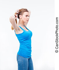 Young woman holding her hair in a ponytail