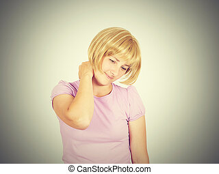 Young woman holding her neck and arm pain.