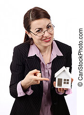 Real estate concept - Young woman holding house model. Real...