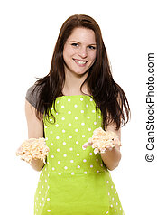 young woman holding messy dough with her handy on white background