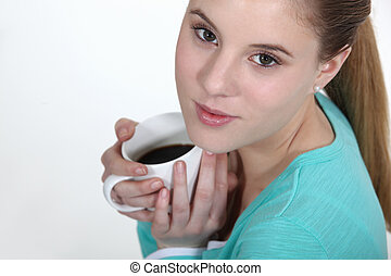 Young woman holding mug of coffee