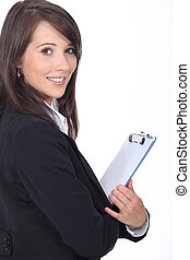 Young woman holding notepad