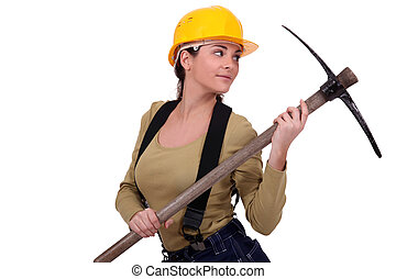 Young woman holding pickaxe