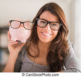 Young Woman Holding Piggy Bank Wearing Glasses