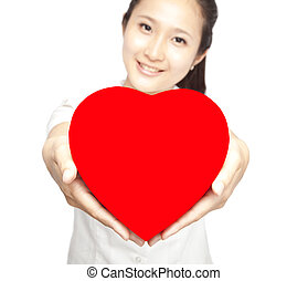 young woman holding red heart symbol