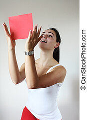 Young woman holding red paper