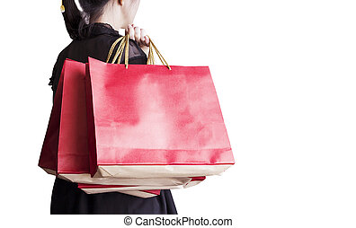 Young woman holding red shopping bag isolated on white background with copy space