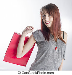 Young Woman Holding Red Shopping Bag