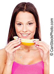woman holding slice of yellow melon