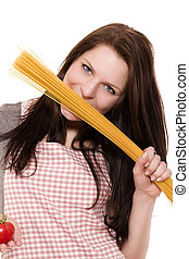 young woman holding spaghetti to her face holding tomato on white background
