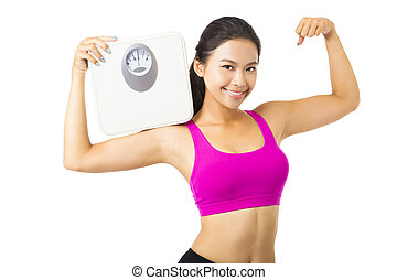 Young woman holding the weight scale